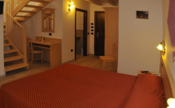 Hotel-Comparsa-Pergine-Valsugana-camera-da-letto